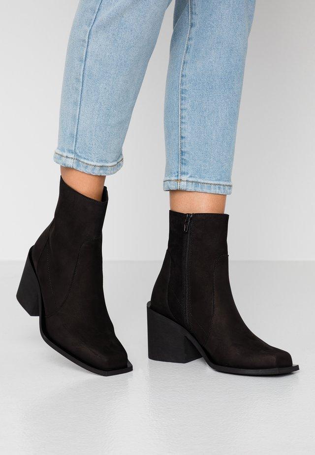RIANE - Cowboy/biker ankle boot - black