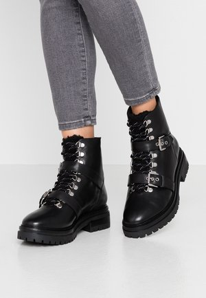 SAWYER - Platform ankle boots - black
