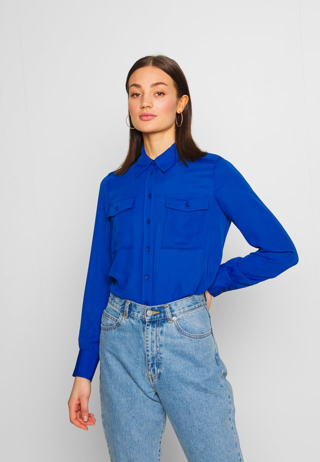 NAHLA BLOUSE - Button-down blouse - blau