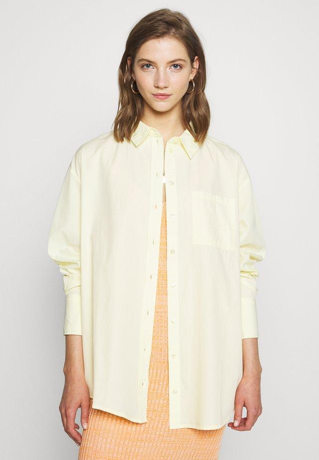 GIANNA - Button-down blouse - gelb