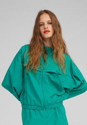 Lehká bunda - green