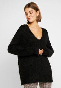 EDITED - FAWINI - Sweter - schwarz - 0