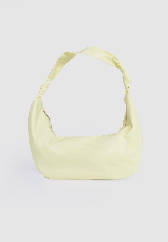 TOSIA - Handtasche - gelb