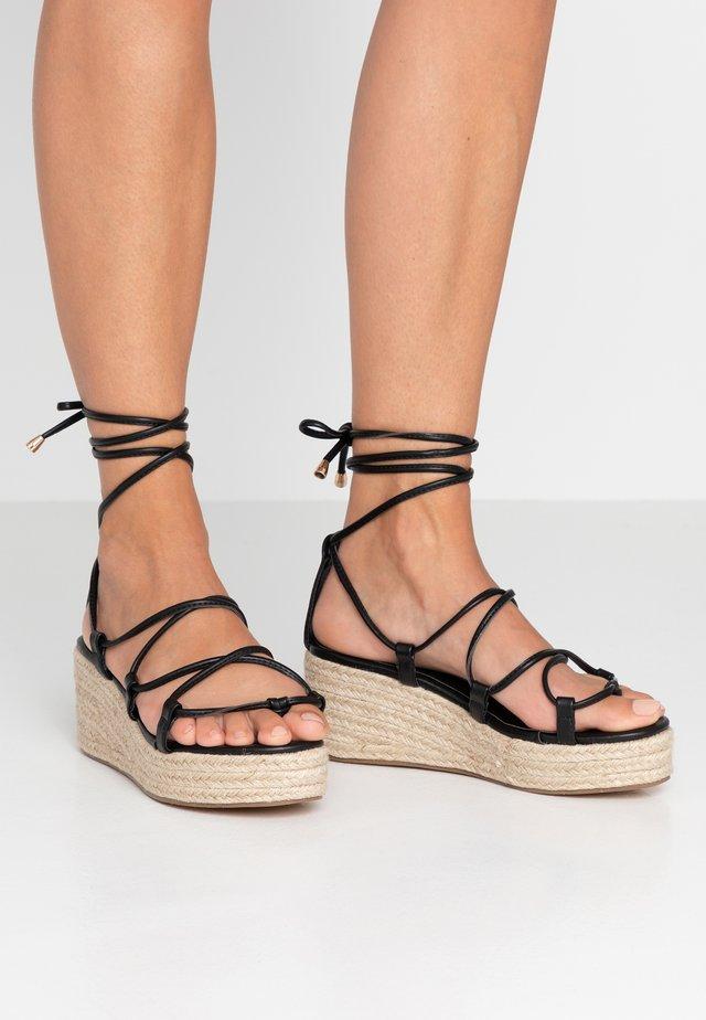 SOPHINA - T-bar sandals - black