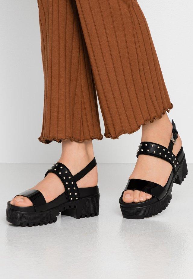 ARIEL - Korkeakorkoiset sandaalit - black