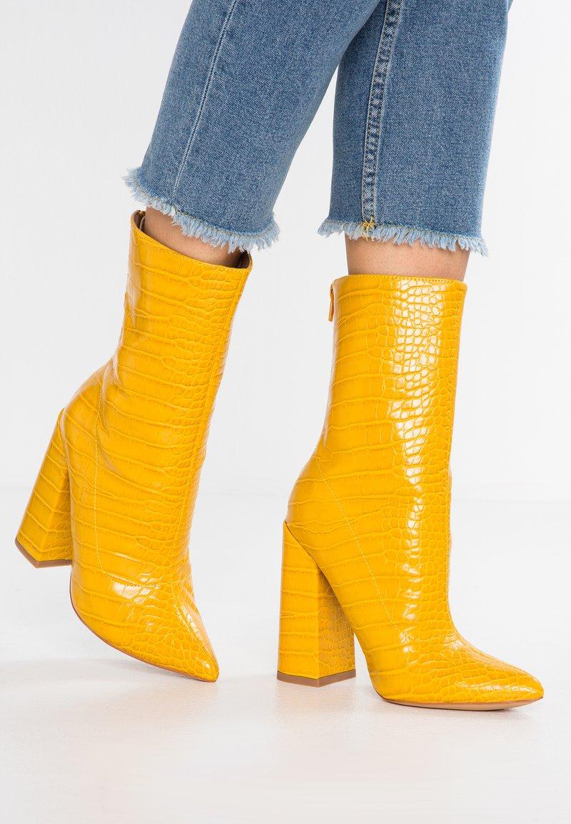 EGO - LAURA - Enkellaarsjes met hoge hak - yellow