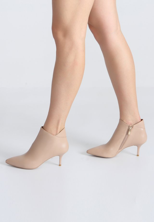 High heeled ankle boots - beige