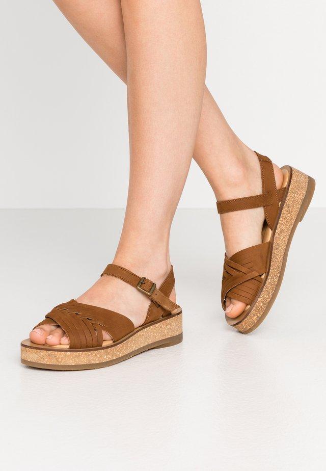 TÜLBEND - Platform sandals - wood