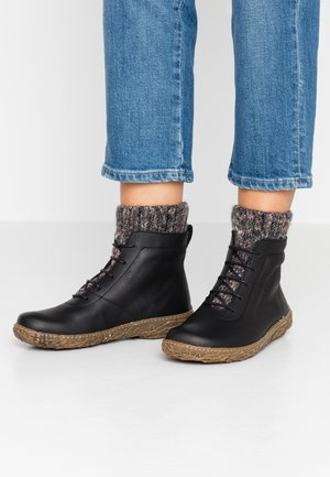 NIDO - Lace-up ankle boots - black