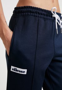 Ellesse - ADALINA - Tracksuit bottoms - navy - 3