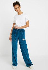 Ellesse - NARCISO - Teplákové kalhoty - teal - 1