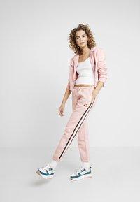 Ellesse - POLPETTO - Teplákové kalhoty - pink - 1