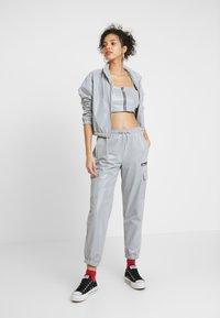 Ellesse - SCENA REFLECTIVE - Teplákové kalhoty - silver - 1