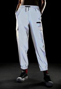 Ellesse - SCENA REFLECTIVE - Teplákové kalhoty - silver - 3