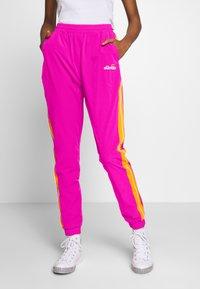 Ellesse - ROSALLA - Tracksuit bottoms - pink - 0