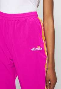 Ellesse - ROSALLA - Tracksuit bottoms - pink - 4