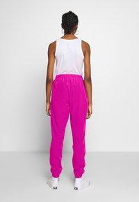 Ellesse - ROSALLA - Tracksuit bottoms - pink - 2
