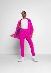 Ellesse - ROSALLA - Tracksuit bottoms - pink - 1