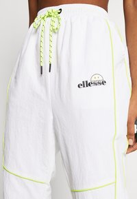 Ellesse - DELLA X SMILEY - Tracksuit bottoms - white - 3