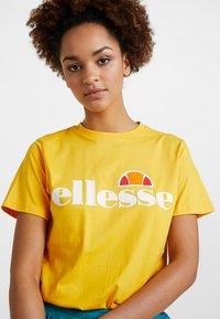 Ellesse - ALBANY - T-shirt print - yellow - 3