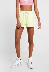 Ellesse - ANDA - Teplákové kalhoty - light yellow - 0