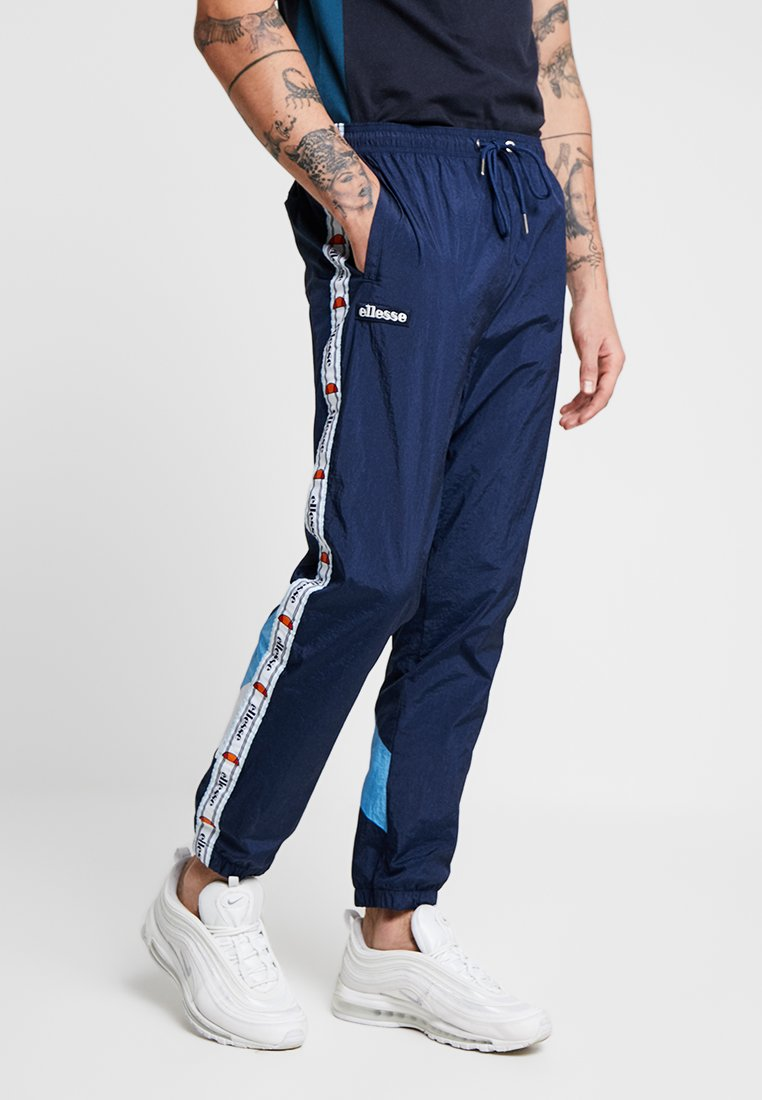 Ellesse - AVICO - Tracksuit bottoms - navy