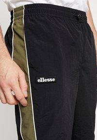 Ellesse - SERIO - Teplákové kalhoty - black - 5