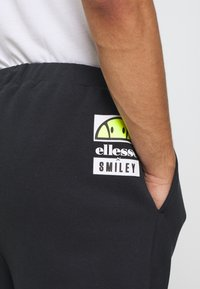 Ellesse - SANT ANDREA - Spodnie treningowe - black - 5