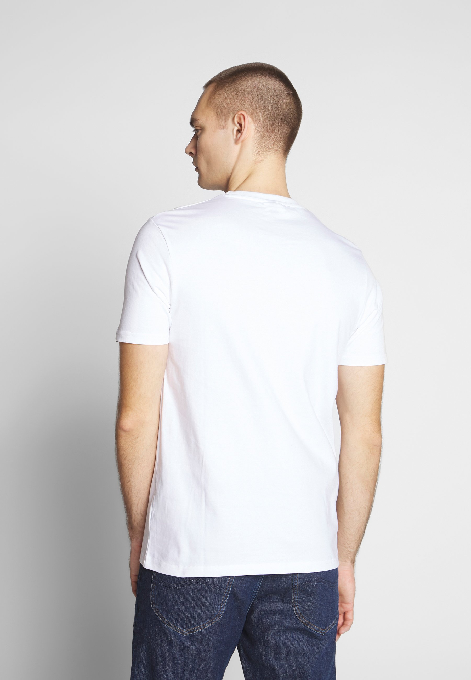 Ellesse MULTIZ - T-shirt z nadrukiem - white