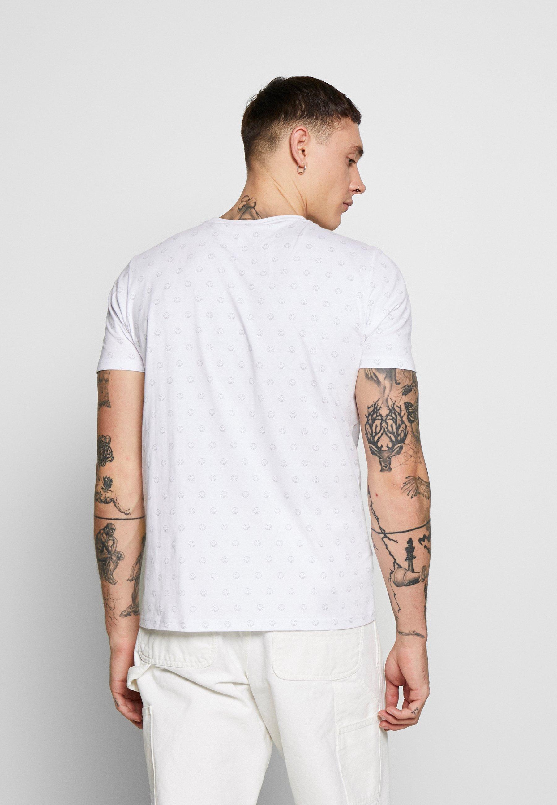 Ellesse FEETA - T-shirt z nadrukiem - white
