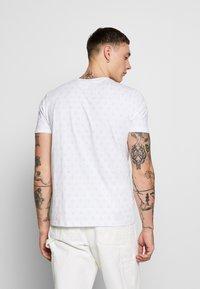 Ellesse - FEETA - T-shirt med print - white - 2