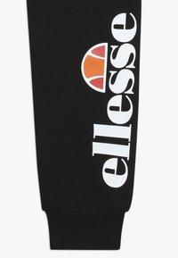 Ellesse - COLINO - Teplákové kalhoty - black - 2