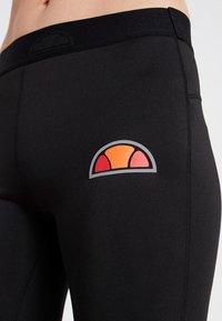 Ellesse - PORTICI - Pantalon 3/4 de sport - black - 4