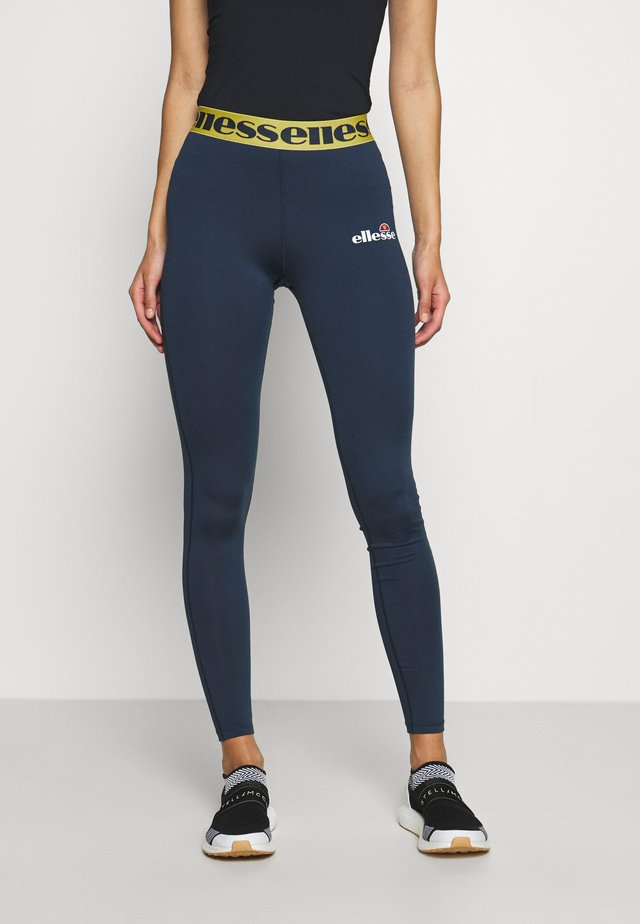TARRES LEGGING - Leggings - navy/yellow
