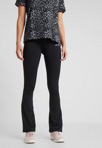 Ellesse - MOLVENO - Spodnie materiałowe - black - 0