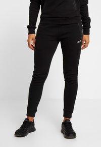 Ellesse - CARPENA - Spodnie treningowe - black - 0