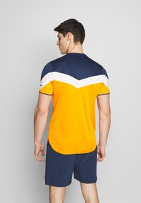 Ellesse - Printtipaita - orange - 2