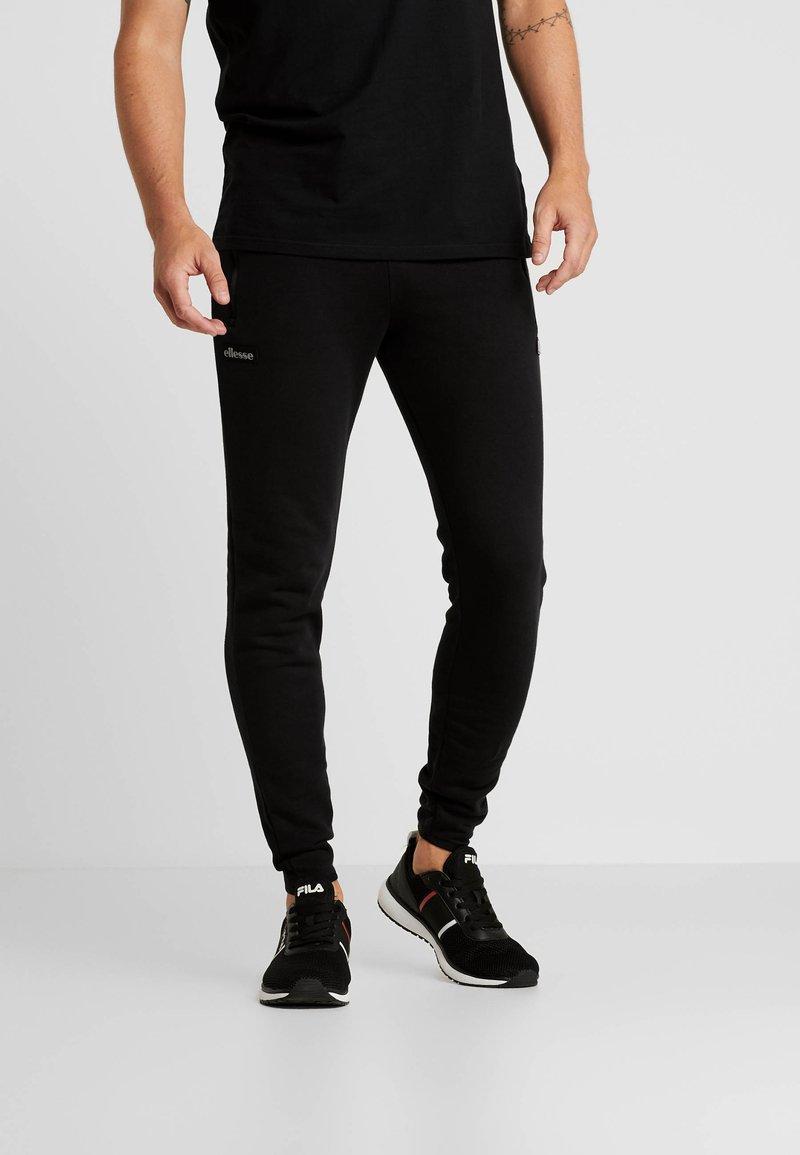 Ellesse - SIMONO  - Pantalones deportivos - black