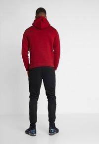 Ellesse - CALDWELO PANT - Teplákové kalhoty - black - 2