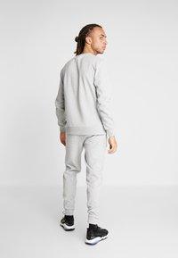 Ellesse - OSTERIA - Pantalones deportivos - grey marl - 2