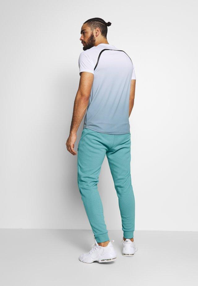 OSTERIA - Teplákové kalhoty - grey