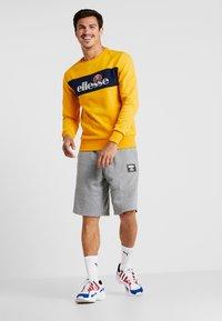 Ellesse - NEBBIOLO - Sweatshirt - dark yellow - 1