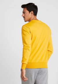 Ellesse - NEBBIOLO - Sweatshirt - dark yellow - 2