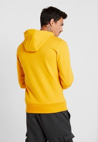 Ellesse - SAGRATINO  - Hoodie - dark yellow - 2