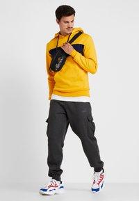 Ellesse - SAGRATINO  - Hoodie - dark yellow - 1