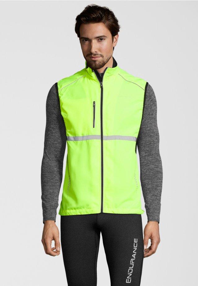 MIT ATMUNGSAKTIVER EIGENSCHAFT - Waistcoat - neon yellow