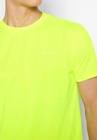 Endurance - VERNON PERFORMANCE TEE - T-shirt basic - safety yellow - 4
