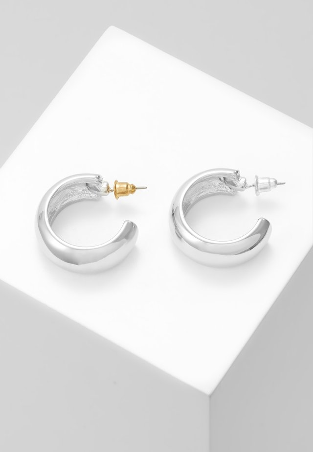 CHUNKY HUGGY HOOP - Earrings - silver-coloured