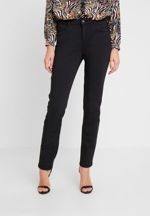 SLIM - Trousers - black