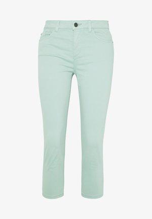 CAPRI - Jeans slim fit - light aqua green